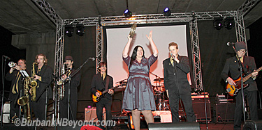 Mayor Anja Reinke got into the evening as she joined the band, Stone Soul      (Photo By Ross A. Benson)