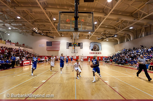 A sold out gym at Burroughs watched the Bulldogs lead from the opening tip off.        (Photo By Steven J. Lynch)