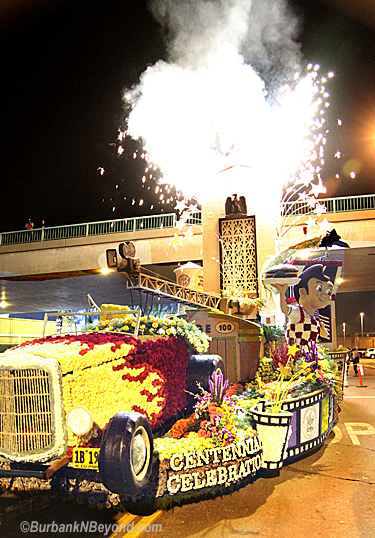 Just before leaving for Pasadena, Burbank's Rose Float gives a fireworks show for the thousands who came out for the sendoff Friday night. All of the hard work and effort was rewarded as the float brought home the Founders Trophy.     (Photo By Ross A. Benson)