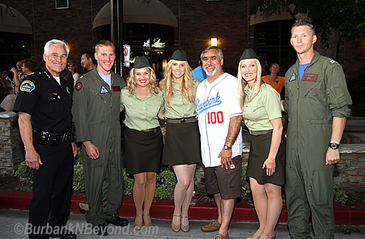 Burbank Police Chief Scott LaChasse is joined with the two pilots of the F-18 fighter jets and  USO Singers along with Mayor Jess Talamantes.