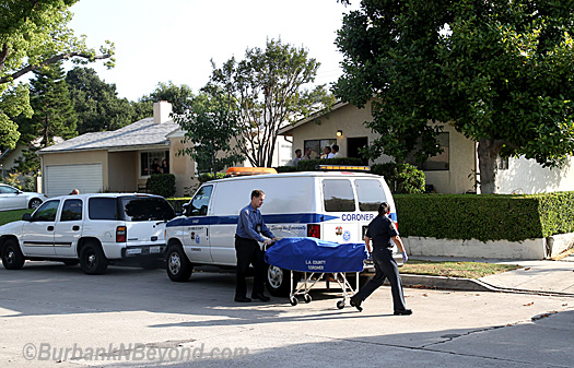 (above)Coroner officials remove the body of 65 year-old Marie Brancato at 815 N. Valley St. Tuesday. (below) Burbank Police Sergeant of Detectives Tony DeSantis and Officer Steve Buteyn investigate the area surrounding the murder (Photos By Ross A. Benson)