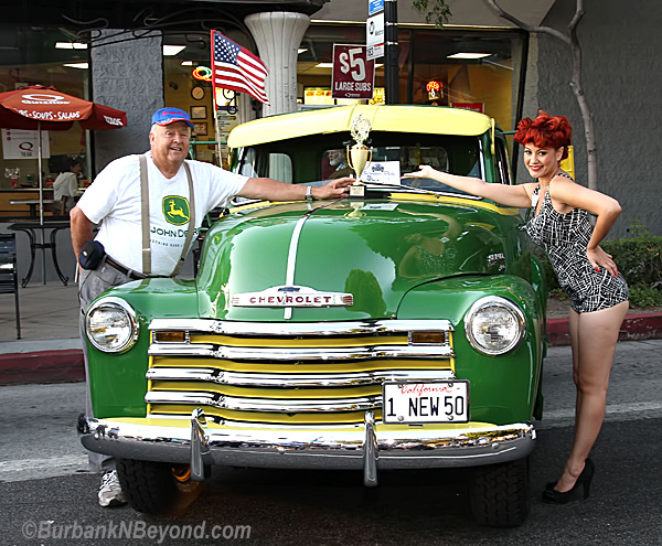 This Classic 1950 Chevy Pickup with original John Deer Paint Job is owned by Edward Tucker.  Here he is receiving his award from model Masaya Palmer.     (Photo By Ross A. Benson)