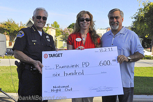 Every year Target is a major sponsor of National Night Out and 2011 was no exception as a Target representative presented Burbank Police Chief Scott LaChasse and Mayor Jess Talamantes a check to help with the City&#039;s expenses.    (Photo By Deborah Dodge)
