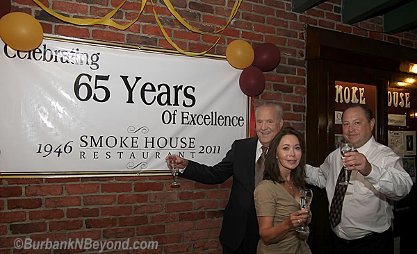 Smoke House owners (L to R) Lee Spencer and his wife Marti along with General Manager Israel Aviles toast the Burbank landmark's 65 anniversary.       (Photo By Ross A. Benson)