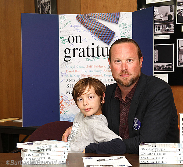 &quot;On Gratitude&quot; author Todd Jenson sits with his son, Julian, at a recent event at the Central Library when they teamed with Operation Gratitude, who support American Troops. &quot;On Gratitude&quot; has been selected by the Burbank Reads program.       (Photo By Ross A. Benson)