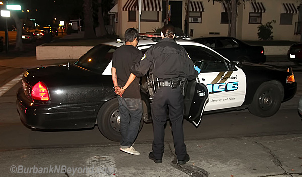 After being arrested for DUI, the driver who caused the accident is led to a police car where he will get a much safer ride to jail  The accident occurred at the Victory and Parish around 2 am Saturday, November 5, 2011.  The driver was taken to the hospital for injuries while the driver was booked for DUI.    (Photo By Ross A. Benson)
