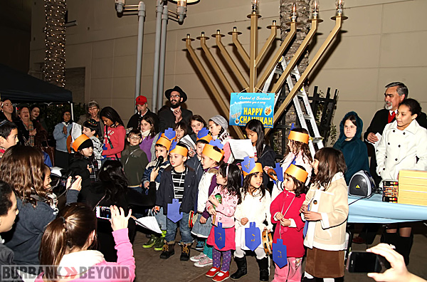 Kids sing Jewish songs of Chanukah following the lighting of the Menorah on the AMC walkway.  (Photo byRoss A. Benson)