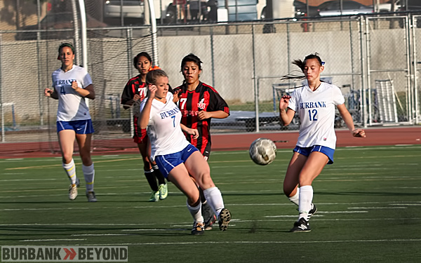 Burbank High&#039;s Maddie Carlborg and Alessia Dal-Monte work the ball. ( Photo by Ross A. Benson)