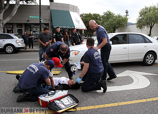 Burbank Fire Paramedics treat this female who was struck while crossing Magnolia Blvd. and Shelton Street Monday afternoon. ( Photo by Ross A. Benson)