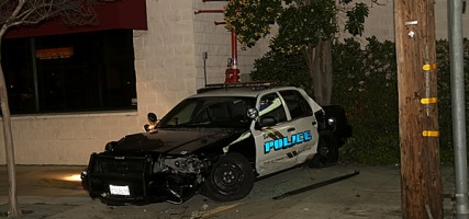 A Burbank Police Car sit against the building where it came to rest following a accident at Magnolia & Victory Friday evening. (Photo by Ross A. Benson)