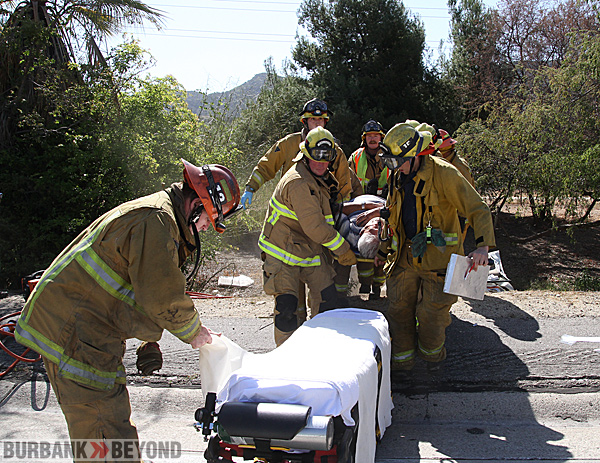 Burbank Firefighters bring the sole occupant of his car after it went over the side in a two cars accident eastbound 134 Fwy @ Buena Vista. (Photo by Ross A. Benson)