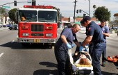 Burbank Paramedics package up a patient who was struck on Magnolia just East of Buena Vista Saturday afternoon. (Photo By Ross A. Benson)