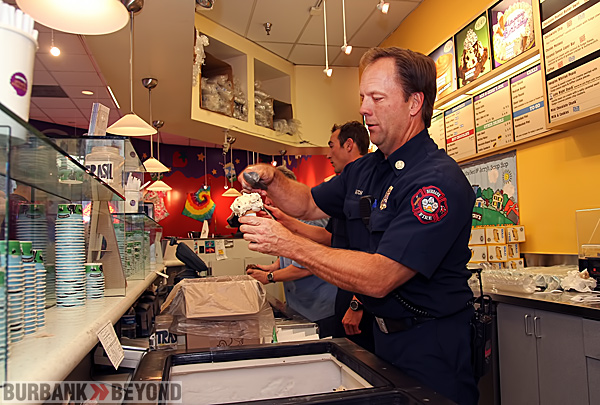 Captain Mark Hatch makes the perfect scoop during Ben &amp; Jerry&#039;s Scoop Event. (Photo by Ross A. Benson)