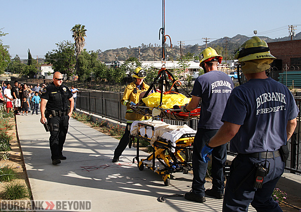 Burbank Firefighters used special stokes basket after lifting this victim from the wash on Alameda Ave. east of Victory Blvd. (Photo by Ross A. Benson)