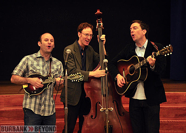 "(L-R) Long-time friends and bandmates, Jacob Tilove, Ian Riggs and Ed Helms make up the bluegrass band, ""Lonesome Trio"".  They perform for the students at Providencia Elementary School."