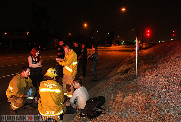 Burbank Paramedics check out this male that was riding his motorcycle and crashed at Lima and the bike ended up at Hollywood Way. (Photo by Ross A. Benson)