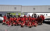 After boarding this private jet the Summer Daze camp poses for a group photo. (Photo by Ross A. Benson)