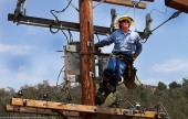 High above it all and working on power lines is Burbank Water & Power's Ryan Reid, this years Linesman's Rodeo first place champion. (Photo by Ross A. Benson)