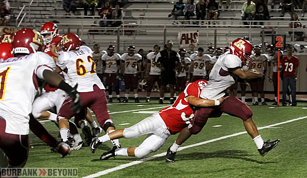 Arcadia's Jake Medel scores on a six-yard touchdown run (Photo by Ross A. Benson)