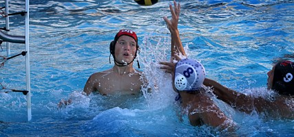 Burbank&#039;s Zachary Card, #8, scores against Indians goalie Dillon Wiegand (Photo by Ross A. Benson)