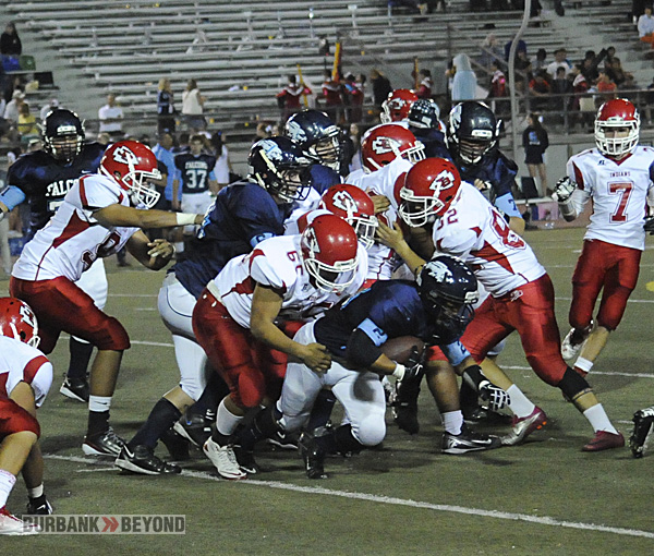 Burroughs defense swarmed the Falcons all evening in the 20-14 win (Photo by Craig Sherwood)