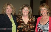 Burbank Woman of the Year Shanna Warren, center, is congratulated by Zonta Club members, President Grace Farenbaugh, left, and Donna Anderson. (Photo by Joyce Rudolph)