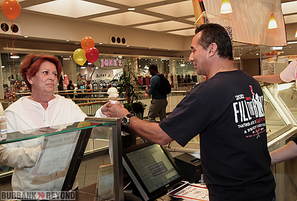 Burbank Firefighter Paramedic Rubin Mercado happily serves up a free scoop of Haagen-Dazs Ice Cream in trade for a donation to MDA. (Photo by Ross A. Benson)