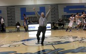 Burbank Coach Jerry DeLaurie raises his arms in triumph after the buzzer-beating victory (Photo by Ross A. Benson)