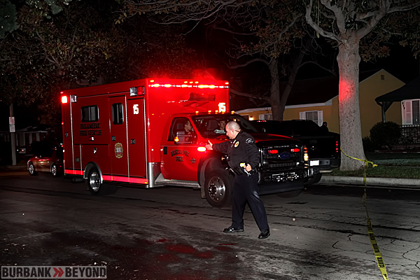 Burbank Police Officer Gil Moreno protects crime scene and blood evidence as Paramedics rush stabbing victim to Holy Cross Trauma Center. (Photo by Ross A. Benson)