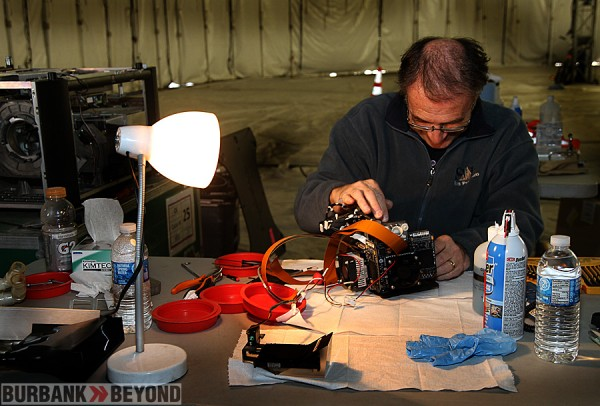 Pierre Rufiange, a technician works on one of the projector parts prior to be put into place. (Photo by Ross A. Benson)