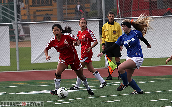 Taylor Bailey controls the ball for Burroughs (Photo by Ross A. Benson)
