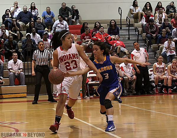 The Indians Paula Galicia dribbles up court against pressure (Photo by Ross A. Benson)