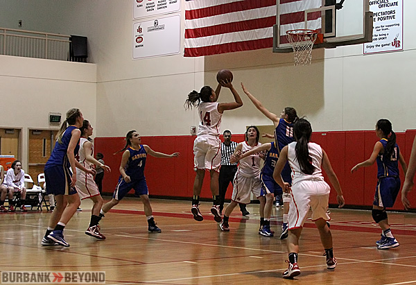 Aysia Shellmire, #14, capped off a spectacular career scoring 24 points (Photo by Ross A. Benson)
