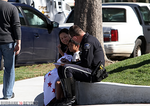 Burbank Police Officer Jim Peterson gathers information following the accident.(Photo by Ross A. Benson)