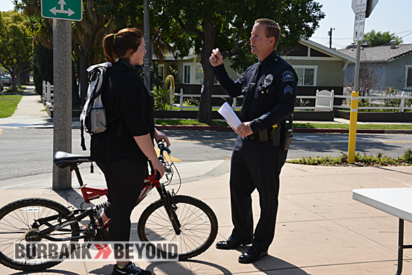 Sgt. Darin Ryburn of the Burbank Police Department educates a rider (Photo By John Savageau)