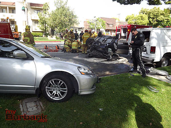 Police examine the area for clues to why the accident occurred (Photo By Nick Colbert)