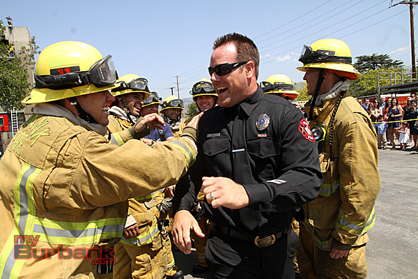 With a BIG THANK YOU Burbank Recruits thank academy instructor Firefighter Ryan Weber, for all his attention to detail and for helping them get through. (Photo by Ross A. Benson)