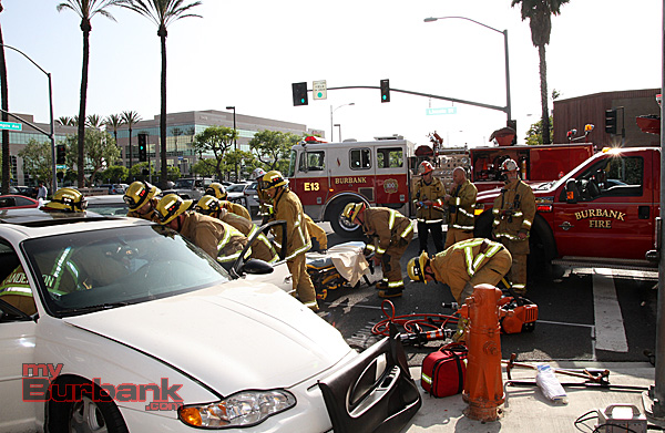 Burbank Firefighters use specialized equipment to get this patient out of her crashed car, prior to being transported to a trauma center for care.(Photo by Ross A. Benson)
