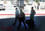 Sheriff Officers take luggage belonging to suspect as evidence. (Photo by Ross A. Benson)