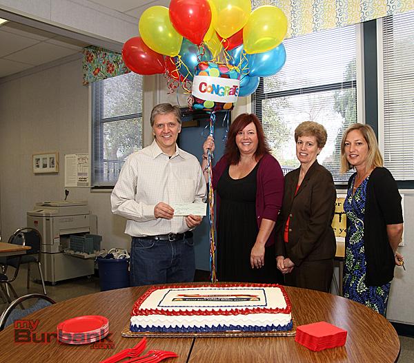 Jordan Teacher Richard Lightfoot, Jamie Keyser , Lisa Rawlins and Principal Stacy Cashman. (Photo by Ross A. Benson)