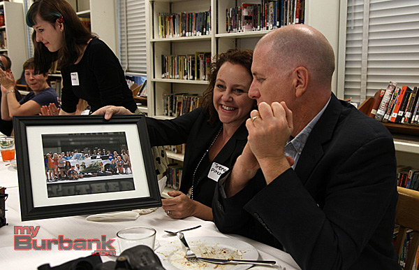 Trena Pitchford – Director of Development of Burbank Arts for All and Board Member Bob Mohler SVP Digital Media Warner Bros. Telepictures Productions, after receiving a framed picture for their help in the VW project. (Photo by Ross A. Benson)