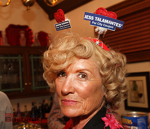 Showing her spirit is Lee Paysinger at the home of former Mayor Mary Lou Howard. (Photo by Ross A. Benson)