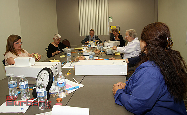 Counting the last of the ballots the clock shows 10:00 a bit quicker than the General Election, and finished hours earlier. (Photo by Ross A. Benson)
