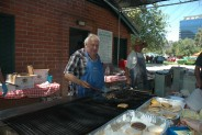Tony Wade, chairman of the Kiwanis For Fun Car Show, mans the grill. The club served 200 people during the pancake breakfast and 800 at lunch.