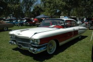 This white 1959 Cadillac has red detailing on the side. It is owned by Scropian Grigor.