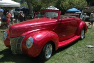 Lori Wilcox's bright pink1944 convertible has flames painted on the hood, front fenders and doors.