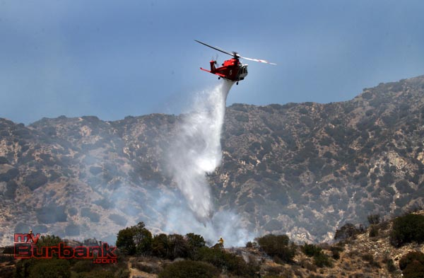 Los Angles City Copter 5 makes a water drop on a hotspot during a small brush fire that occurred above DeBell hole 16. (Photo by Ross A. Benson)