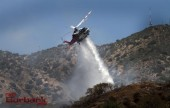 Los Angeles City Copter 5 makes a drop on a small brush fire that occurred Monday afternoon near DeBell golf course. (Photo by Ross A. Benson)