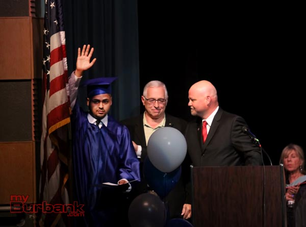 Rotary Scholarship award winner Omar Pena is presented his award from Rotary Members Barry Gussow and Mike Thomas.(Photo by Ross A. Benson)