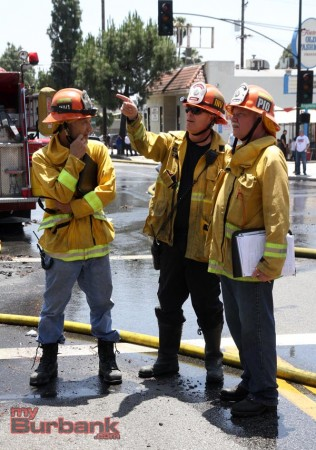 Burbank's Fire Investigator Scott Nishhisaka along with Pasadena Fire Investigator  talk to PIO Peter Hendrickson, at the scene of Burbank's 4th alarm blaze. (Photo by Ross A. Benson)
